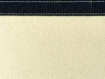 Canvas with leather strip and stitching Stock Image