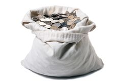 Canvas money bag. Sprouting crisp metal coins Royalty Free Stock Images