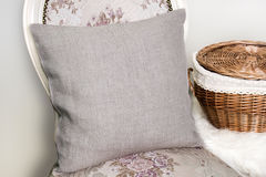 Canvas pillow cushion case Mockup. Canvas pillow, cushion on a chair, Mockup royalty free stock image