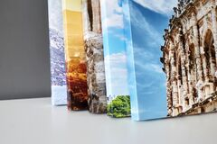 Free Canvas Prints Stacked On White Surface. Photo Printed On Canvas Stock Images - 216927054