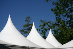 Canvas roof. White Tent roof against a bright blue sky Stock Image