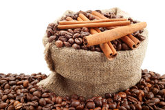 Canvas sack with coffee beans and cinnamon sticks Royalty Free Stock Images