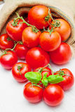 Canvas sack full of  red cherry tomatoes Stock Images