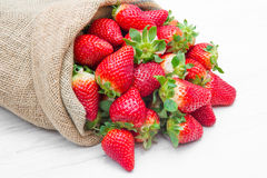 A canvas sack full of  red strawberry Royalty Free Stock Photo
