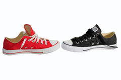 Canvas shoe balttle with white background, red and black shoe Royalty Free Stock Images