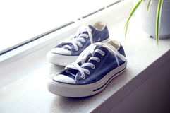Canvas shoe. The blue canvas shoe on the window Stock Photo
