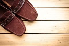 Canvas shoes on wooden floor background. Canvas shoes on a wooden floor background Stock Photography