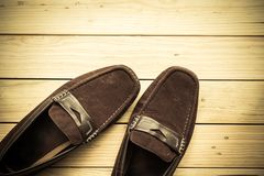Canvas shoes on wooden floor background. Canvas shoes on a wooden floor background Stock Photos
