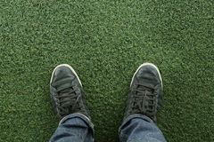 Canvas sneakers on grass Royalty Free Stock Image