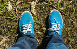 Canvas sneakers with jeans Royalty Free Stock Photos