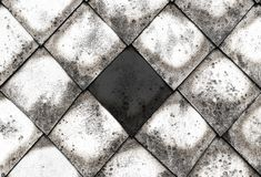 Canvas stone gray cement rhombus in the center dark contrast part of the old roof windy covered with black spots base of the city royalty free stock photos