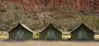 Canvas Tents at Campsite in Outback Australia. Three green canvas tents stand stand side by side at a campsite at Glen Helen, Central Australia royalty free stock images
