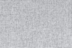 Canvas textile texture of white fibers on a dark background. Plain weave, close up.  stock photo
