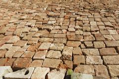 The canvas of the village road lined neatly with a broken brick Stock Photo