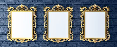 Canvas with vintage golden frames on brick wall. Of the gallery 3d render Royalty Free Stock Photos