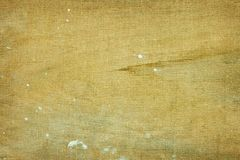 Canvas + wood textured mix. Shabby stained background with paint and wounds stock photo