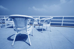 Cany chair on ship's deck Stock Photo