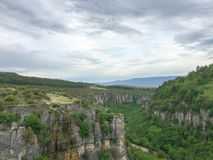 Canyon background. With cloudy sky and trees Stock Image