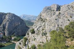 The canyon of the Cetina river in omiš, Croatia. Picturesque canyon of the Cetina river between the mountains in Omis Croatia on a Sunny summer day royalty free stock photo