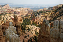 Canyon Colors. Landscape image of sandstone spires (hoodoos) and cliffs with different colors at Bryce Point, in Bryce Canyon National Park, Utah Royalty Free Stock Photo