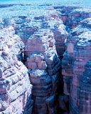Canyon crevasse. Towering rock formations in a deep canyon Royalty Free Stock Photos