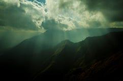 Canyon deep. Deep canyon with sunlight beaming through the clouds Stock Photos