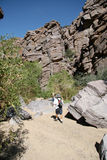 Canyon Hiker. A hiker walks toward a photographer in the Promised Land Canyon, Chino Valley Arizona Stock Photo