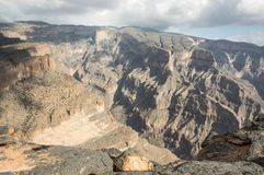 Canyon in Jabal Shams. Oman showing many layers of geotectonical and erosion powers Royalty Free Stock Image