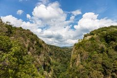 Canyon in the mountains through which flows a small mountain river, Krasnodar region, Russia.  stock photography