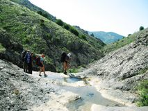 Canyon Panagia in Crimea. Four tourists on the canyon Royalty Free Stock Image