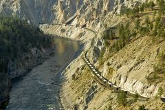 Canyon Railway. A train winds it's way through the Fraser Canyon north of Lytton, BC Canada Royalty Free Stock Photos