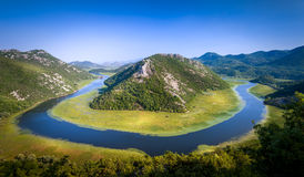Canyon of river Crnojevica, where it makes a turn over the green mountain. Royalty Free Stock Images