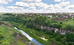 Canyon of the river and houses under cloudy sky in Kamenetz Podo Stock Images
