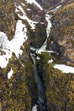 Canyon with River, Rocks Sandwiched between Snowfall Royalty Free Stock Photos