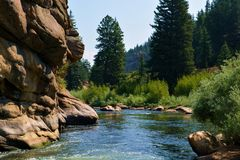 Rock Canyon River Water. Water flows through a canyon in the mountains on a sunny day Royalty Free Stock Photo