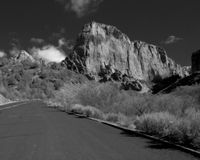 Canyon Road - Black and White. A Black and White view of a canyon road in Zion National Park, in southern Utah Stock Images