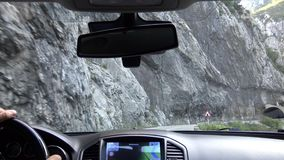 Canyon and the road from the car. Canyon of the river Tara. Cliffs protrude on both sides. Shooting was made from the passenger compartment. Zabljak stock video