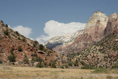 Canyon Scene. Distant landscape image of a cloud over colorful rock formations in Zion National Park, Utah Stock Photos