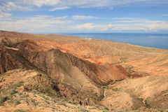 The canyon Skazka (Fairy Tale) and Issyk Kul lake on the background, Kyrgyzstan Stock Photos