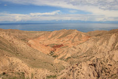 The canyon Skazka (Fairy Tale) and Issyk Kul lake, Kyrgyzstan Stock Photography