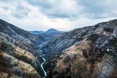 The canyon of Tara river (Kanjon rijeke Tare) in Montenegro. The Balkans - the second largest canyon in the world – on a cloudy winter day. View from the Stock Photos