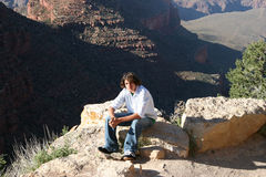 Canyon Teen Boy. Teenage boy sitting near edge at Grand Canyon. Shot with Canon 20D Royalty Free Stock Photo