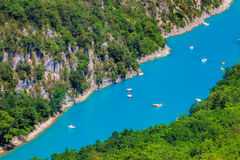Canyon of Verdon with boats in Provence, France. The largest alpine canyon in Europe. Royalty Free Stock Photo