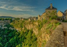 Canyon in the village of Bozouls. Bozouls, Midi Pyrenees, France - September 21, 2017: View of the houses at the edge of the canyon in the village of Bozouls in Royalty Free Stock Photography