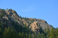 Big Rock Canyon Wall. A mountain canyon wall with trees on a sunny day Stock Image