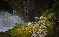 Canyoner in a big Waterfall in Canyon of Anaye royalty free stock image