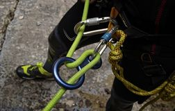 Canyoner getting ready to get off rappelling in simple rope Royalty Free Stock Images