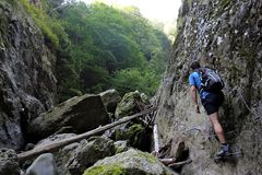 Canyoning - climing stairs on the canyon wall Royalty Free Stock Image