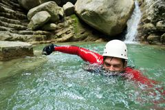 Man canyoning in the Pyrenees, Spain. Stock Images