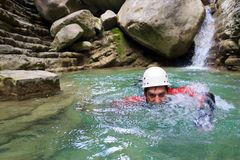 A man swimming in Pyrenees, Spain. Royalty Free Stock Image